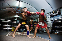 Luk Mi 10 years old (left) and Hiu Kiho 10 years old (right) a young kid fighters, are training at one of the street gyms in Bangkok. The gym at the Sam Soen neighborhood is managed by At, who is hosting and training over 10 kids an average. Over though is banned by law, in the streets of Thailand thousands of kids are training daily to attain a dream, become a Muay Thai champions one day, getting wealth and fame to leave out poverty and lackness instead. One by thousand each shall get it, meanwhile mostly of them will go keeping on the way to be someone.