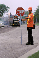 Flagman on Road Resurfacing Project