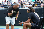 Wake Forest Demon Deacons head coach Tony Bresky talks to Skander Mansouri during a change-over at #3 singles against the Texas A&M Aggies during the semifinals at the 2018 NCAA Men's Tennis Championship at the Wake Forest Tennis Center on May 21, 2018 in Winston-Salem, North Carolina. The Demon Deacons defeated the Aggies 4-3. (Brian Westerholt/Sports On Film)