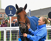 Winner of The British Stallion Studs EBF Upavon Fillies' Stakes Fanny Logan ridden by Robert Havlin and trained by John Gosden with Lass in the Winner's enclosure during Horse Racing at Salisbury Racecourse on 14th August 2019