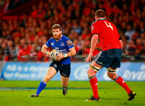 05.10.2013 Limerick, Ireland. Gordon D'Arcy (Leinster) attempts to cut inside Donnacha Ryan (Munster) during the RaboDirect Pro 12 game between Munster and Leinster from Thomond Park.