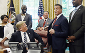United States President Donald J. Trump acknowledges actor Sylvester Stallone after signing  an Executive Grant of Clemency  for former heavyweight champion Jack Johnson in the Oval Office of the White House on May 24, 2018 in Washington, DC. <br /> Credit: Olivier Douliery / Pool via CNP