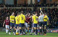 The match gets heated for a second time with players jumping in after a yellow card during the Sky Bet League 2 match between Oxford United and Northampton Town at the Kassam Stadium, Oxford, England on 16 February 2016. Photo by Andy Rowland.