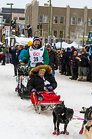 Tom Frode Johansen and team leave the ceremonial start line with an Iditarider and handler at 4th Avenue and D street in downtown Anchorage, Alaska on Saturday March 7th during the 2020 Iditarod race. Photo copyright by Cathy Hart Photography.com