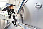 """In this photo made available on May 31, 2012 shows Mao Sugiyama riding up the escalator at a train station in Kanagawa, near Tokyo, Japan, on May 29, 2012. Mao Sugiyama, 22, self-described as an asexual now just 2 months old, is a cartoonist, painter and illustrator living in Japan. Mao hated the idea of love and sex due to a series of past events relating to close people around him becoming victims of sexual crimes. In an effort to free himself from mankind, Mao underwent a surgical procedure in Tokyo to remove his male genitals and later serve them to paying guests at a small dinner event. He spent two years conducting extensive research about the removal of his genitals and had several sexual experiences with others prior to the surgery. The reasoning behind Mao's idea to host an event where he would cook his male parts and serve them to guests, was he needed to earn money to help cover the ongoing medical costs of the procedure. Five individuals consisting of men and women out of a small crowd who attended the dinner, ate Mao's specially cooked genitals. The men, however, were not able to completely finish eating the genitals as they grew disgusted whereas the women were able to finish everything on their plates entirely. The women commented on Mao's parts as """"delicious."""" With Mao being an artist that he is, his vision is to create beautiful art without the realization of being a man or woman and excluding love and sex out of his system completely. (Photo by Christopher Jue/Nippon News)"""
