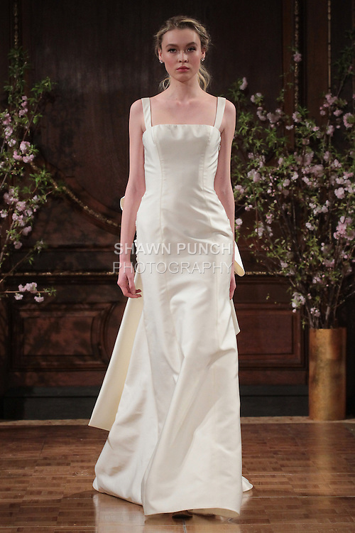"Model walks runway in a ""Jesse"" bridal gown from the Isabelle Armstrong Spring Collection 2017, at Lotte New York Palace Hotel, during New York Bridal Fashion Week Spring Summer 2017 on April 16, 2017."