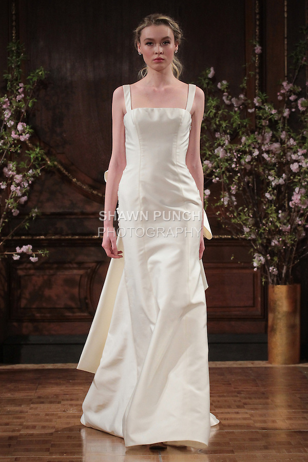 """Model walks runway in a """"Jesse"""" bridal gown from the Isabelle Armstrong Spring Collection 2017, at Lotte New York Palace Hotel, during New York Bridal Fashion Week Spring Summer 2017 on April 16, 2017."""