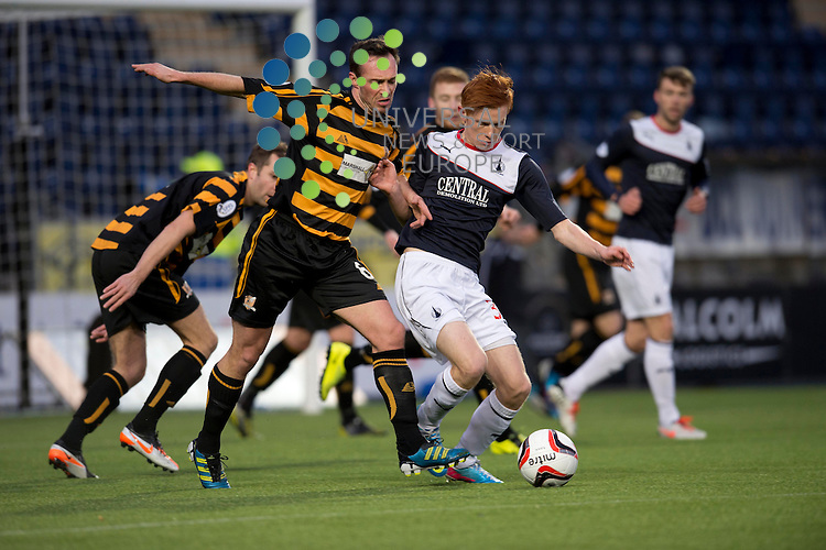 Darren Young of Alloa  challenges for the ball against Scott Shepherd of Falkirk during the Scottish Championship match between Falkirk and Alloa at The Falkirk Stadium, Falkirk. 28 December 2013. Picture by Ian Sneddon / Universal News and Sport (Scotland). All pictures must be credited to www.universalnewsandsport.com. (Office) 0844 884 51 22.