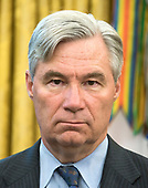 "United States Senator Sheldon Whitehouse (Democrat of Rhode Island) looks on as US President Donald J. Trump makes remarks prior to signing S. 3508, the ""Save Our Seas Act of 2018"" in the Oval Office of the White House in Washington, DC on Thursday, October 11, 2018. <br /> Credit: Ron Sachs / CNP"