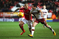 Josh MaGennis of Charlton Athletic tries to shake off a challenge from Bradford City's Ryan McGowan during Charlton Athletic vs Bradford City, Sky Bet EFL League 1 Football at The Valley on 13th February 2018