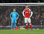 Arsenal's Laurent Koscielny looks on dejected after PSG's opening goal during the Champions League group A match at the Emirates Stadium, London. Picture date November 23rd, 2016 Pic David Klein/Sportimage