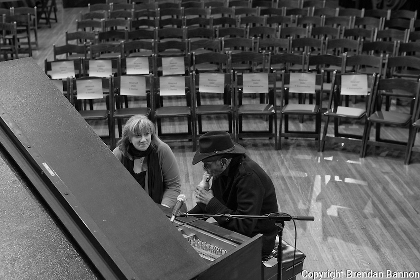 Nurse Kate Wannemacher checks up on Boyd Lee Dunlop before his CD release concert  at Hallwalls in Buffalo, NY. Dunlop, a nursing home resident  released his first CD in 2011 at age 85.
