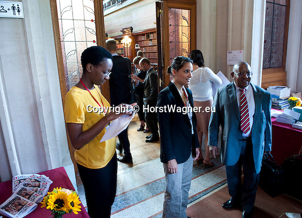 """Brussels-Belgium - June 21, 2012 -- """"Call to Europe II"""" - a conference held at the Bibliotheque Solvay by FEPS - Foundation for European Progressive Studies; here, at the entrance - registration with Marie-Astrid MUKANKUSI (le) and ISCHI GRAUS (ce)-- Photo © HorstWagner.eu"""