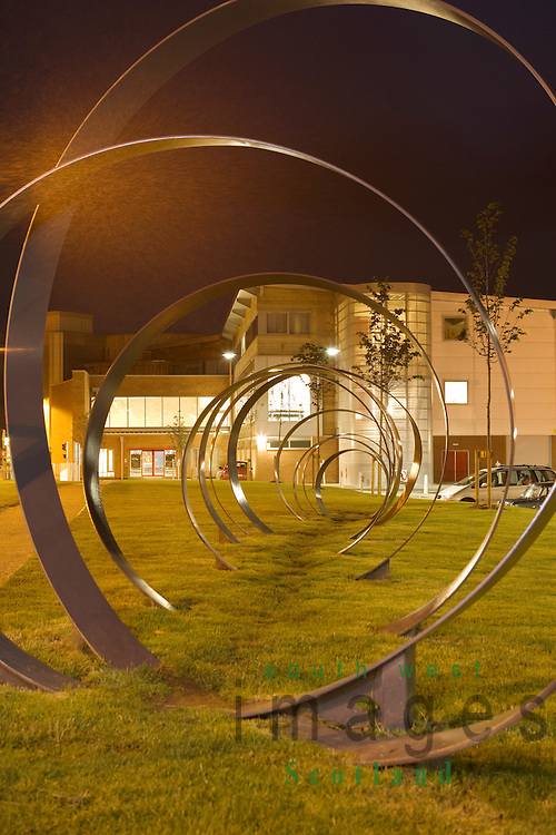Dumfries town centre the Spring sculpture by Walter Jack at DG1 leisure complex at night Scotland UK