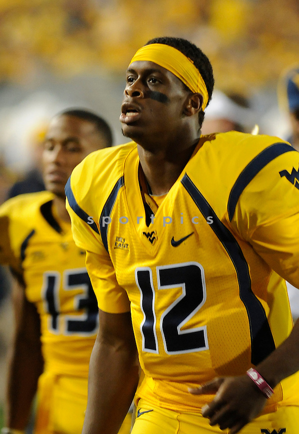 GENO SMITH, of the West Virginia Mountaineers, in action during West Virginia's game against LSU on September 24, 2011 at Mountaineer Field at Milan Puskar Stadium in Morgantown, WV. LSU beat West Virginia 47-21.