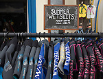 Summer wetsuits on sale at the seaside town of Cromer, north Norfolk coast, England