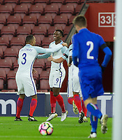 Brendan Galloway (West Brom (on loan from Everton) of England congratulates Demarai Gray (Leicester City) of England on scoring the opening goal during the Under 21 International Friendly match between England and Italy at St Mary's Stadium, Southampton, England on 10 November 2016. Photo by Andy Rowland.