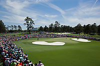 April 13th, 2013, Augusta GA, USA;   Audience watch Tiger Woods of the United States competing during the third round of the 2013 Masters golf tournament at the Augusta National Golf Club in Augusta