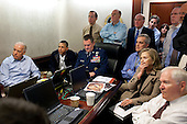 "May 1, 2011.""Much has been made of this photograph that shows the President and Vice President and the national security team monitoring in real time the mission against Osama bin Laden. Some more background on the photograph: The White House Situation Room is actually comprised of several different conference rooms. The majority of the time, the President convenes meetings in the large conference room with assigned seats. But to monitor this mission, the group moved into the much smaller conference room. The President chose to sit next to Brigadier General Marshall B. ""Brad"" Webb, Assistant Commanding General of Joint Special Operations Command, who was point man for the communications taking place. WIth so few chairs, others just stood at the back of the room. I was jammed into a corner of the room with no room to move. During the mission itself, I made approximately 100 photographs, almost all from this cramped spot in the corner. There were several other meetings throughout the day, and we've put together a composite of several photographs (see next photo in this set) to give people a better sense of what the day was like.  Seated in this picture from left to right: Vice President Biden, the President, Brig. Gen. Webb, Deputy National Security Advisor Denis McDonough, Secretary of State Hillary Rodham Clinton, and then Secretary of Defense Robert Gates. Standing, from left, are: Admiral Mike Mullen, then Chairman of the Joint Chiefs of Staff; National Security Advisor Tom Donilon; Chief of Staff Bill Daley; Tony Blinken, National Security Advisor to the Vice President; Audrey Tomason Director for Counterterrorism; John Brennan, Assistant to the President for Homeland Security and Counterterrorism; and Director of National Intelligence James Clapper. Please note: a classified document seen in front of Secretary Clinton has been obscured."" .Mandatory Credit: Pete Souza - White House via CNP"