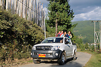 Bhutanese girls on a Toyota car at Bumthang, Bhutan. Arindam Mukherjee.