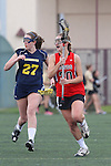 Santa Barbara, CA 02/18/12 - Maddie Palmer (Michigan #27) and Katie Ezell (Georgia #20) in action during the Georgia-Michigan matchup at the 2012 Santa Barbara Shootout.  Georgia defeated Michigan 12-10.