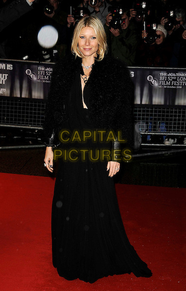 "GWYNETH PALTROW .at the London Film Festival screening of ""Two Lovers"" at the Vue West End, London, England, .October 20th 2008..full length long black dress maxi jacket fluffy wool leather cuffs  grey gray nails nail varnish polish.CAP/CAN.©Can Nguyen/Capital Pictures"