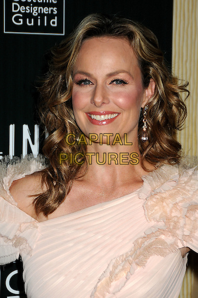 MELORA HARDIN .13th Annual Costume Designers Guild Awards held at The Beverly Hilton Hotel, Beverly Hills, California, USA, .22nd February 2011..portrait headshot smiling beige cream nude ruffle .CAP/ADM/BP.©Byron Purvis/AdMedia/Capital Pictures.