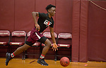 WATERBURY, CT-120618JS11-Sacred Heart's Caleb Sampson pushes the ball up court as they run drills during practice Thursday at Alumni Hall. <br /> Jim Shannon Republican American