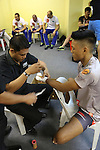 Gianni Subba, Malaysian MMA hero getting hands bandaged before fighting<br /><br />MMA. Mixed Martial Arts &quot;Tigers of Asia&quot; cage fighting competition. Top professional male and female fighters from across Asia, Russia, Australia, Malaysia, Japan and the Philippines come together to fight. This tournament takes place in front of a ten thousand strong crowd of supporters in Pelaing Stadium. Kuala Lumpur, Malaysia. October 2015