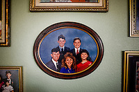 A family portrait of the Grahams hangs on the wall of their Fort Carson home...Major General Mark Graham and his wife, Carol, talk about the deaths of their two sons in their Fort Carson home in Colorado Springs, Colo.  Their son, Second Lt. Jeff Graham was killed by a roadside bomb in Iraq just months after their other son, ROTC Cadet Kevin Graham, committed suicide in his apartment.  Since Kevin's suicide, the Grahams have been outspoken advocates for suicide prevention.