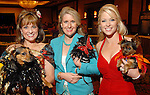 From left: Pamela Wright with Delta, Kim Tenenbaum with Jade and Allie Morgan with Bella at the Citizens for Animal Protection owner/pet fashion show at the Hilton Americas Houston Saturday June 06,2009.(Dave Rossman/For the Chronicle)