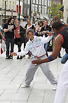 Shannon Stowe tries some capoeira at the Samba Festival on West Street...(Photo credit should read Jenny Matthews www.newsfile.ie)....This Picture has been sent you under the conditions enclosed by:.Newsfile Ltd..The Studio,.Millmount Abbey,.Drogheda,.Co Meath..Ireland..Tel: +353(0)41-9871240.Fax: +353(0)41-9871260.GSM: +353(0)86-2500958.email: pictures@newsfile.ie.www.newsfile.ie.