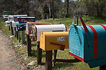 Mailbox row along a country road, Mariposa County, Calif.