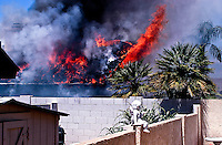 AJ Alexander Photojournalist - Home Fire off of 40th St. and Tierra Buena in North Phoenix East (Paradise Valley) cross streets are 40t St. and Greenway. Tuesday July 26, 2011..Photo by AJ Alexander/ajaimages.photoshelter.com