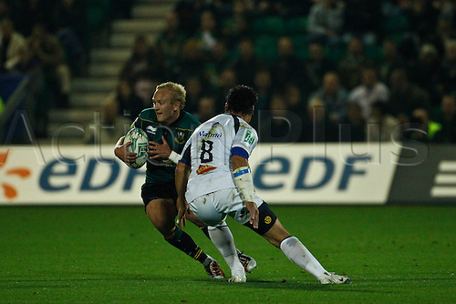 Northampton's Shane Geraghty side steps past Castres' Chris Mascoe.  08.10.2010 Rugby Union Heineken Cup from Franklin's Gardens Northampton Saints v Castres.  Final score : Northampton 18-14 Castres