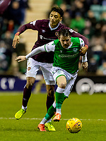 3rd March 2020; Easter Road, Edinburgh, Scotland; Scottish Premiership Football, Hibernian versus Heart of Midlothian; Sean Clare of Hearts and Marc McNulty of Hibernian compete for possession of the ball