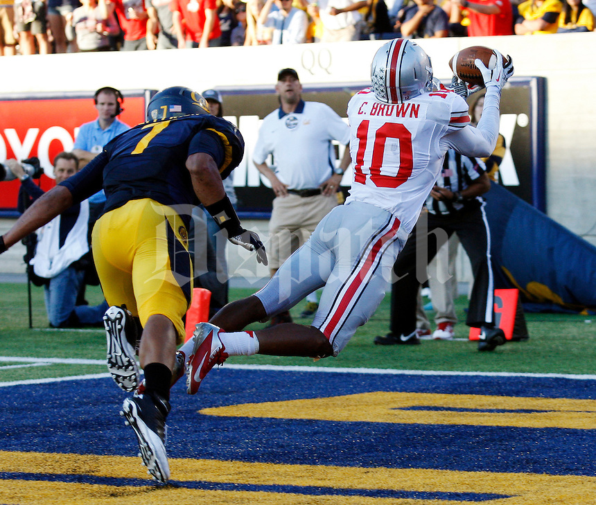 Ohio State Buckeyes wide receiver Philly Brown (10) catches a touchdown pass behind California Golden Bears linebacker Jalen Jefferson (7) during the third quarter of the NCAA football game at Memorial Stadium in Berkeley, California on Sept. 14, 2013. (Adam Cairns / The Columbus Dispatch)