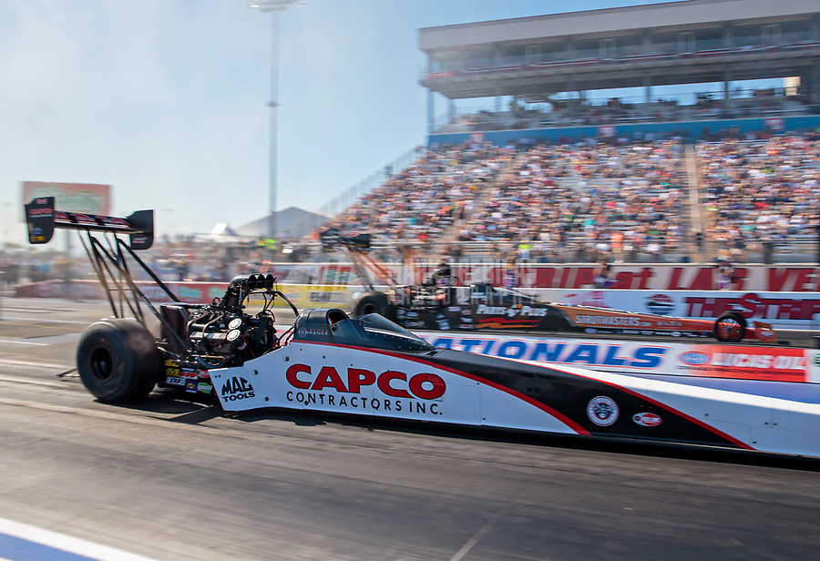 Oct 26, 2018; Las Vegas, NV, USA; NHRA top fuel driver Steve Torrence (near) races alongside Clay Millican during qualifying for the Toyota Nationals at The Strip at Las Vegas Motor Speedway. Mandatory Credit: Mark J. Rebilas-USA TODAY Sports