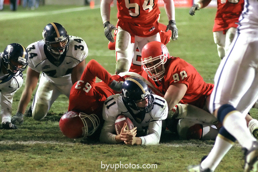 FTB 2312 G-6<br /> <br /> BYU at Utah. 11 Brandon Doman Quarterback. 34 Brandon Heaney.<br /> <br /> Nov 24, 2000<br /> <br /> Box: in office<br /> <br /> Photo by: Mark Philbrick/BYU<br /> <br /> Copyright BYU PHOTO 2008<br /> All Rights Reserved<br /> 801-422-7322<br /> photo@byu.edu