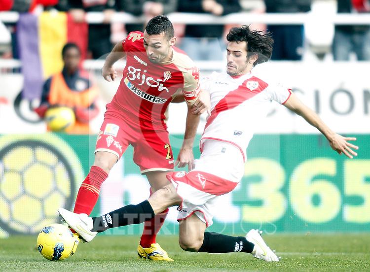 Sporting de Gijon's David Barral against Rayo Vallecano's Alejandro Arribas during La Liga Match. December 11, 2011. (ALTERPHOTOS/Alvaro Hernandez)