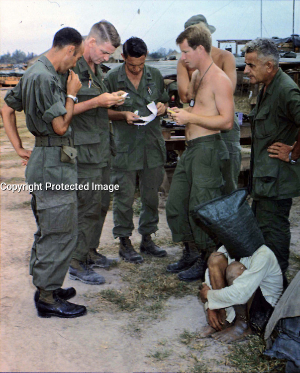 12/20/1968 File Photo -   Viet Cong suspect, captured during an attack on an American outpost near the Cambodian border in South Vietnam, is interrogated.