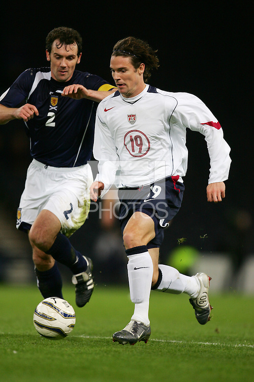 Christian Dailly of Scotland and Heath Pearce of USA