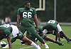 Claude Pelon #66 stretches during New York Jets Training Camp at the Atlantic Health Jets Training Center in Florham Park, NJ on Monday, Aug. 14, 2017.