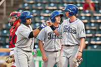 July 21, 2010 Wilin Rosario (20) congratulated by his team after hitting a home run during the MiLB game between the Tulsa Drillers and the Springfield Cardinals at Hammons Field in Springfield Missouri.  Tulsa won 5-3