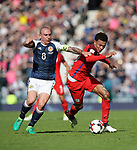 Scotland's Scott Brown tussles with England's Dele Alli during the FIFA World Cup Qualifying match at Hampden Park Stadium, Glasgow Picture date 10th June 2017. Picture credit should read: David Klein/Sportimage