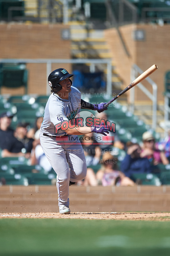 Salt River Rafters Colton Welker (34), of the Colorado Rockies organization, hits a double during the Arizona Fall League Championship Game against the Surprise Saguaros on October 26, 2019 at Salt River Fields at Talking Stick in Scottsdale, Arizona. The Rafters defeated the Saguaros 5-1. (Zachary Lucy/Four Seam Images)