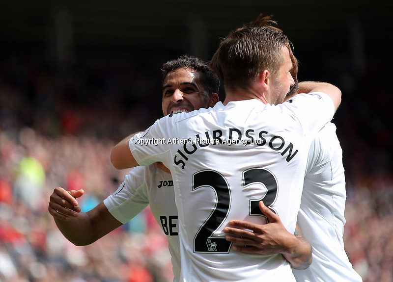 SUNDERLAND, ENGLAND - MAY 13: Kyle Naughton of Swansea City (L) celebrates his goal with team mates Ki Sung-Yueng and Gylfi Sigurdsson during the Premier League match between Sunderland and Swansea City at the Stadium of Light, Sunderland, England, UK. Saturday 13 May 2017