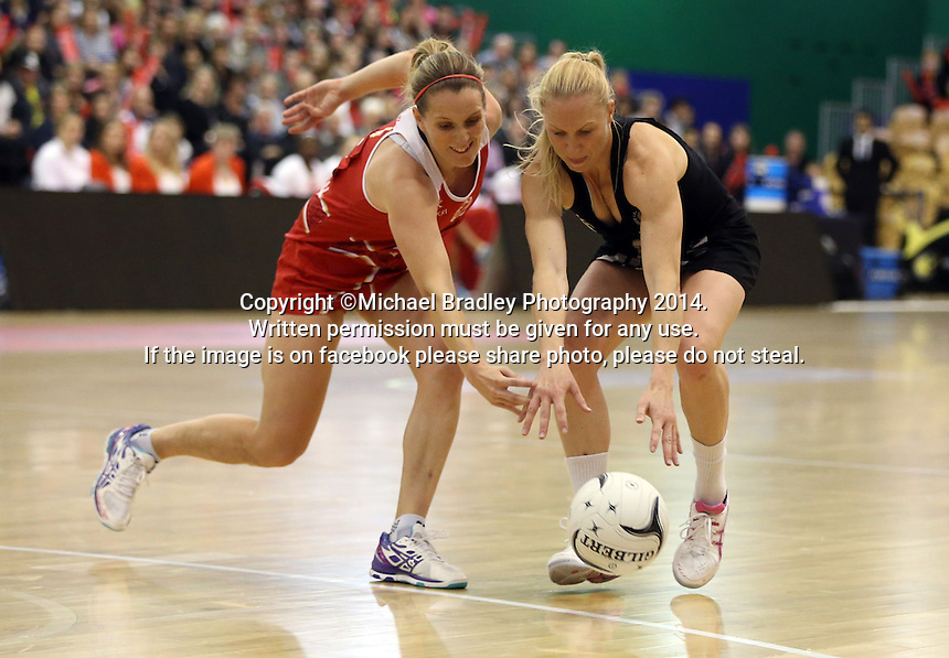 31.10.2014 Silver Ferns Laura Langman and England's Sara Bayman in action during the Silver Ferns V England netball match played at the Arena Manawatu in Palmerston North. Mandatory Photo Credit ©Michael Bradley.