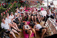Waiting time between heats for Copenhagen Dragonboat Team.Today is raceday. Second round of heats saturday.<br />  IBCPC Dragon Boat Festival i Firenze er en dragebådsfestival for brystkraftramte kvinder. Copenhagen Dragonboat Team deltager med godt 20 kvinder i alderen fra 25 til 62.<br /> <br /> Foto: Jens Panduro<br /> <br /> The IBCPC Dragon Boat Festival is held every four years under the auspices of the International Breast Cancer Paddler's Commission. The Festival is an international non-competitive participatory event targeting Breast Cancer Survivors teams who engage in Dragon Boat activities as post-operative rehabilitation. Born from the idea of a Canadian sports medicine physician, Doctor Don McKenzie about twenty years ago, Dragon Boat paddling has become a rehabilitation therapy for tens of thousands of men and women worldwide, who have undergone surgery.<br /> For the first time since its institution in 2005, the IBCPC FESTIVAL will be held in Europe – in Italy!! The Florence 2018 Festival will involve 129 teams from 17 countries , and for the very first time ALL the continents are represented.<br /> Organised and promoted by FIRENZE IN ROSA Onlus as the official Organising Committee, the Florence Festival will be a sporting event but above all a social occasion in which Florence will welcome from 4,000 to 5,000 people from all over the world. The participants are mainly women between the ages of 20 and 80, who will meet to take part in the exciting Dragon Boat races, paddling together on the Arno. They will also be accompanied by their friends and family, their faithful and enthusiastic supporters.
