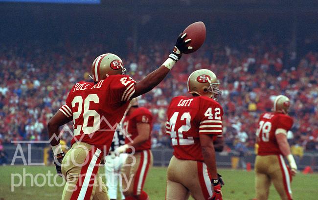 San Francisco 49ers vs Washington Redskins at Candlestick Park Saturday, January 12, 1991..49ers beat Redskins 28-10.49er defensive back Darryl Pollard (26) celebrate interception...